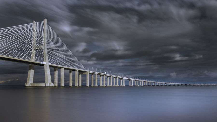 Architecture Beauty In Nature Bridge - Man Made Structure Built Structure Cloud - Sky Connection Day Nature No People Outdoors Sea Sky Storm Cloud Suspension Bridge Water Weather