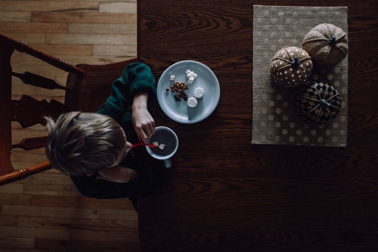 Hot cocoa Hot Chocolate Hot Drink Indoors  High Angle View Childhood Child Directly Above Flooring Offspring Table Sitting Home Interior Hardwood Floor One Person Lifestyles Wood Domestic Room