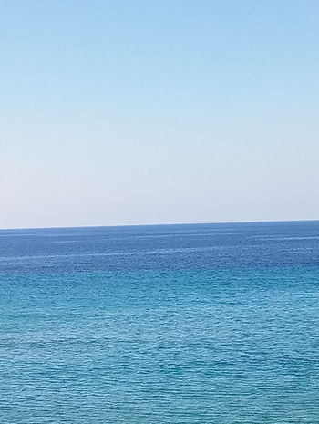Sea Blue Nature Beauty In Nature Horizon Over Water Water Outdoors Scenics Tranquility Sky No People Beach Tranquil Scene Day Summer Pastel Colored Vacations Clear Sky View Into Land Perspectives On Nature