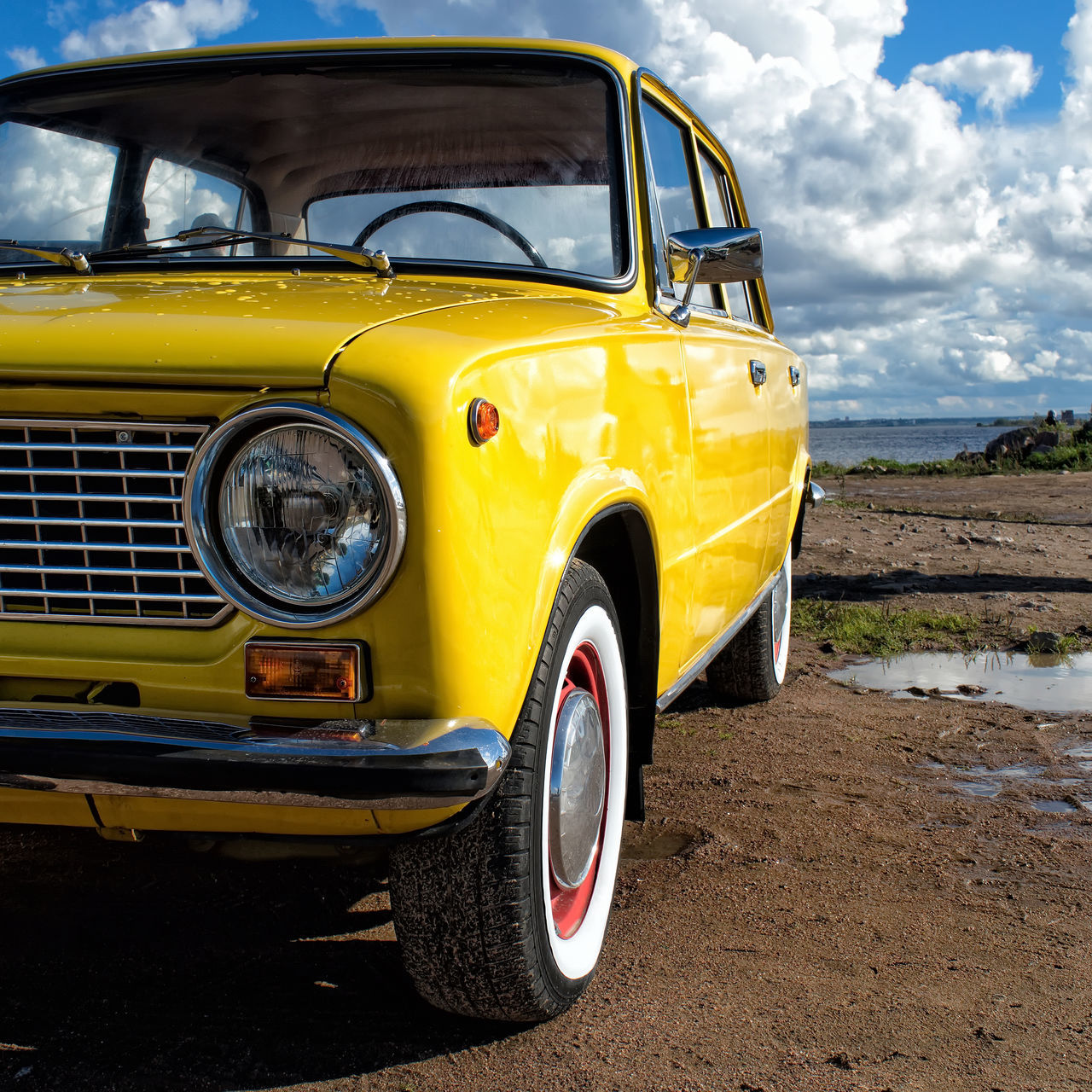 Yellow Car Against Sky
