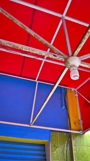 Detail of colorful vendor stall in Mexico City Colors Mexico City Vivid Absence Architecture Backgrounds Blue Built Structure Ceiling Close-up Day Full Frame Hanging Indoors  Low Angle View Metal No People Red