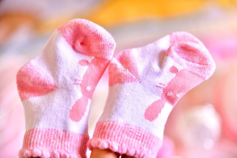 Pink baby socks beautiful color,(photo blurred.) Love Happy Sweet Cute Baby Beautiful Baby Socks Socks Soft Focus Close-up Pink Color Indoors  Focus On Foreground No People Creativity Glove Love Textile Animal Representation Representation Heart Shape Art And Craft Security Softness Toy Healthcare And Medicine Wrapped