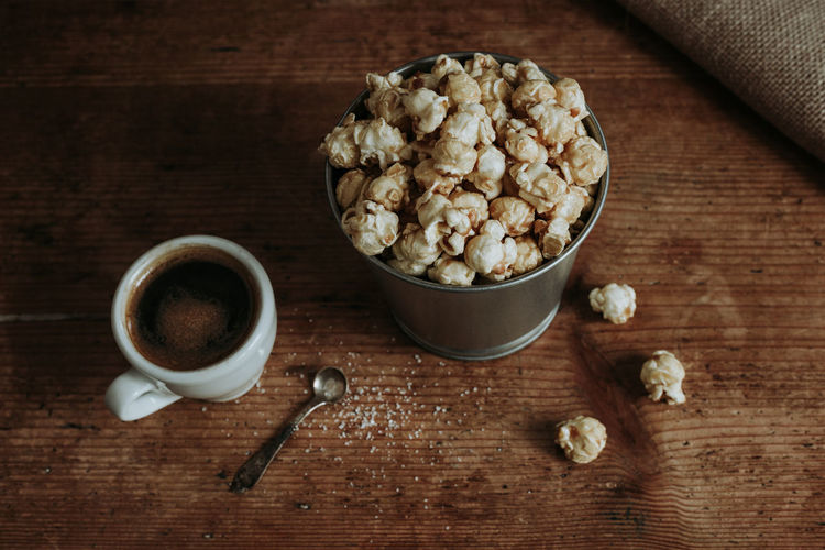 Coffee and popcorn snack Popcorn Coffee Food And Drink Food Wood - Material Freshness Table Indoors  Cup Drink Wellbeing Refreshment Directly Above Bowl No People Still Life Spoon Coffee - Drink Snack