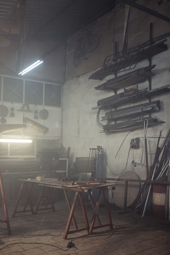 Seat Lighting Equipment Chair Indoors  Absence Illuminated No People Table Empty Architecture Built Structure Domestic Room Arts Culture And Entertainment Wall Business Stage Light Wall - Building Feature Ceiling Workshop Junk Yard Junk