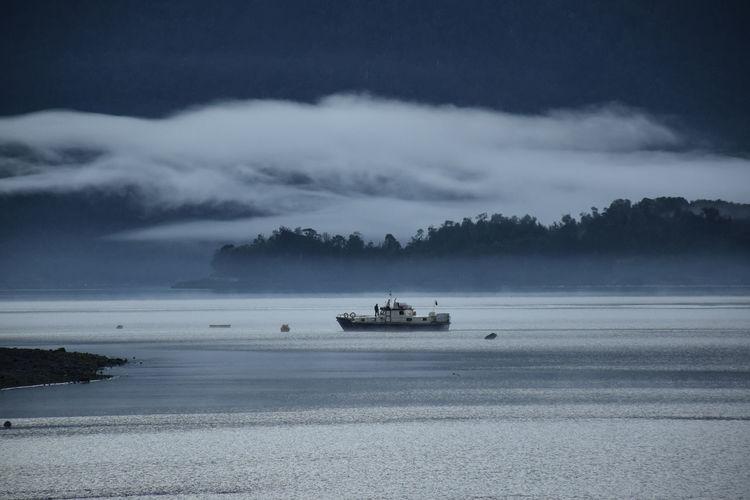 Fishing boat on river at dusk
