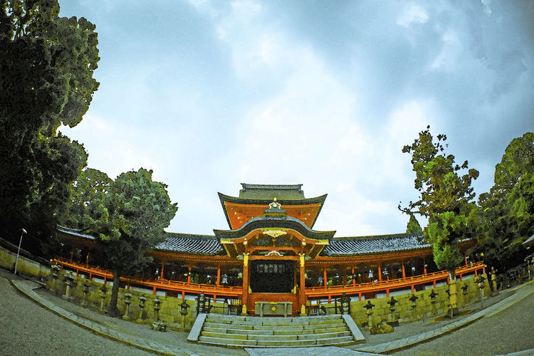 The photograph was taken at Iwashimizu Hachiman-gu Shrine in Kyoto pref., Japan. Architecture Building Exterior Built Structure Cloud - Sky EyeEm Best Shots - Landscape Fineartphotography Fotoartsnippon Japanphotography Nippon Photography Nippon Travel No People Place Of Worship Sky Travel Destinations Tree