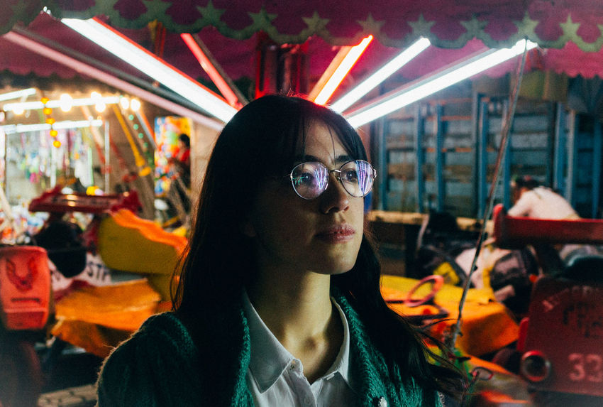 De entre todas las luces, estas tú. Close-up Day Eyeglasses  Focus On Foreground Front View Illuminated Indoors  Lifestyles Looking At Camera Neon Life Neon Lights One Person Portrait Real People Sunglasses Young Adult Young Women EyeEmNewHere The Week On EyeEm