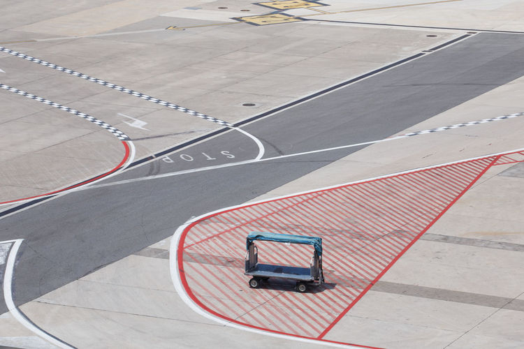no baggage // Airport Airport Waiting Anger Baggage Baggage Cart Baggage Claim Cart Day Delay Empty High Angle View Late Lost Missing No People Outdoors Preparation  Road Road Marking Runway Stop Suitcase Taxiway Transportation Traveling Let's Go. Together.