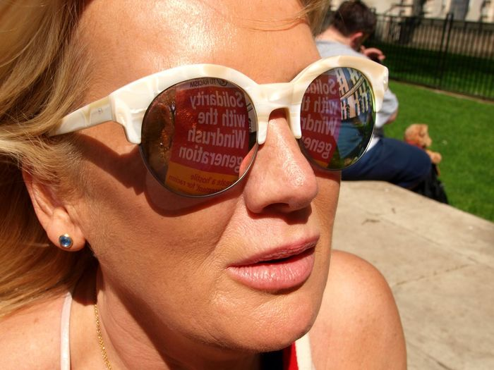 March For Windrush-Scrap Mays Racist Act Protest. Whitehall. London. 05/05/2018 Reflection Immigration Protest Institutional Racism Hostile Environment Protest Windrush Scandal Zuiko Windrush Protest Olympus London News Placards Steve Merrick Stevesevilempire Glasses Fashion Sunglasses One Person Adult Leisure Activity Real People Close-up Sunlight Women Headshot