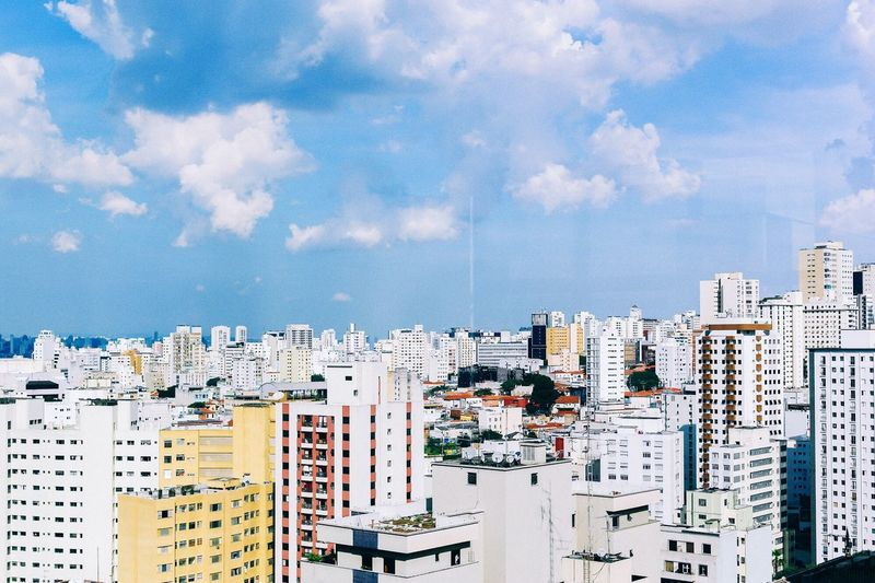Showcase April Window with a view 💙☁️ View From My Window Buildings Skyscraper Sky Blue Blue Sky Sunny Day Sunny Sao Paulo - Brazil Cityscapes Cityscape City Genuine Brazil Images Color Palette