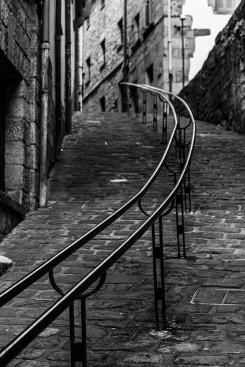 Walk in old town of Orio, close to Zarautz, Basque Country Architecture Built Structure Building Exterior Railing No People Metal Day The Way Forward Building City Focus On Foreground Direction Connection Outdoors Transportation Nature Staircase Footpath Track Railroad Track Long Blackandwhite Black And White City Urban Geometry
