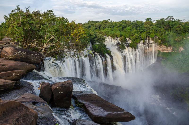 Scenic view of kalandula falls against sky, angola, africa