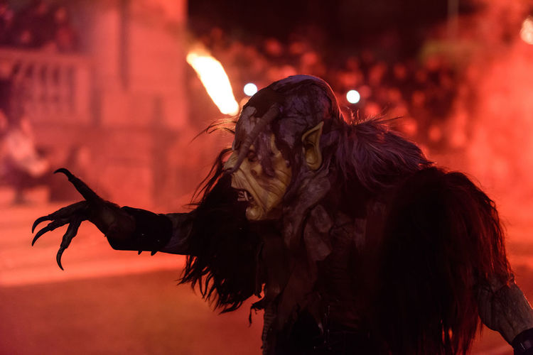 Man with spooky make-up performing at traditional event