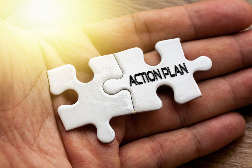 Action plan word written on puzzle with hand background Close-up Day Human Body Part Human Hand Indoors  Jigsaw Puzzle One Person People Puzzle  Solution Strategy