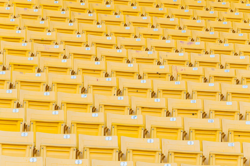 Full frame shot of yellow seats