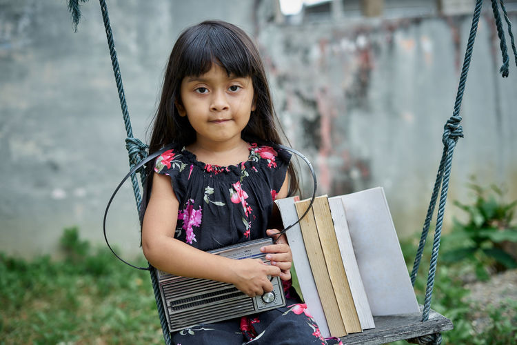 Portrait of happy girl standing outdoors