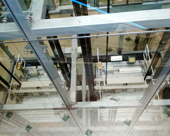 High Angle View Steps And Staircases Railing Indoors  Architecture Elevator Elevator Shaft Mechanical Things Enginneering Steel Structure  Reflection Floor