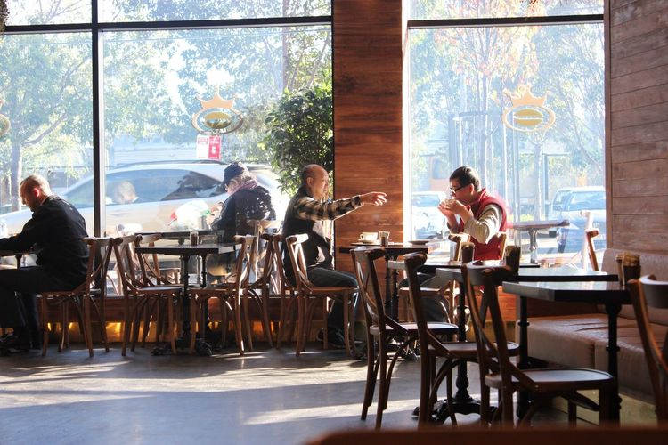 Perfect morning Cafe Latte Cafe Time Morning Rituals Coffee Fix Seat Chair Men Sitting Adult Group Of People Window Table Indoors