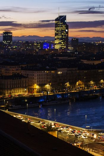 View of Lyon, the Incity tower ans the Rhône in the foregroung Nikon Nikonphotography Work EyeEm Selects Onlylyon Lyon Night Business Finance And Industry Architecture Illuminated City Water Built Structure Cityscape Building Exterior Skyscraper No People Outdoors Urban Skyline Sky Mobility In Mega Cities