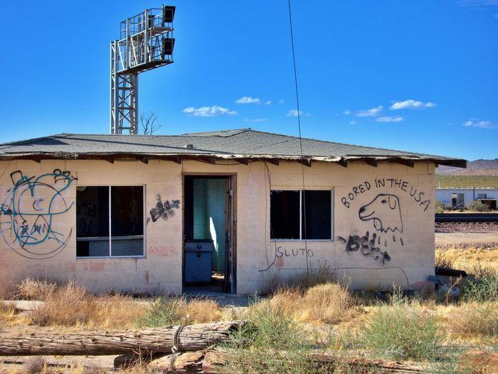 Abandoned building against blue sky