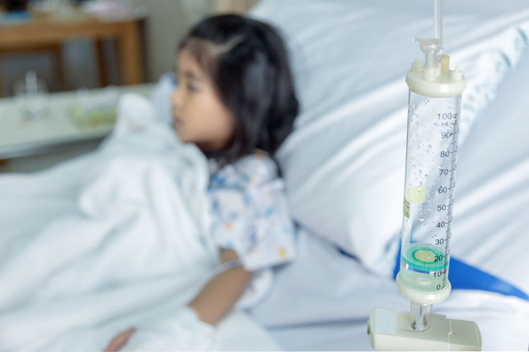 doctor heal Influenza A virus or H1N1 flu asian kid on hospital bed. Medicine virus situation when kid have high fever. Doctor use stethoscope to hear pulp Recovery Intravenous Patient Kid Vein Treatment Injection Child Drop Hospital Therapy Cancer Clinic Needle Surgery Medicine Disease Epidemic Tube Care Chemotherapy Drug Healing Sick Cure Medical Saline Emergency Drip InFusion Equipment Fluid Pediatrician Liquid Fever Influenza Flu Health Family Illness Urgency Girl Recuperation Dose Ailment Ill Droplet Transfuse Glucose Blood Virus