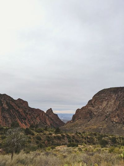 Scenic view of rocky mountains against sky. the window in big bend national park during winter.