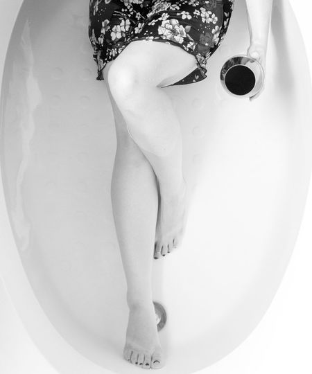Low section of woman in bathroom