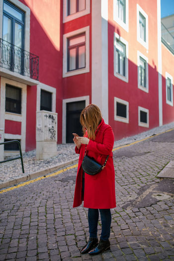Red on red! Red One Person Building Exterior Architecture Women Built Structure Full Length City Lifestyles Footpath Real People Day Standing Street Young Adult Adult Clothing Leisure Activity Young Women Cobblestone Warm Clothing Outdoors Hairstyle Paving Stone Lisboa
