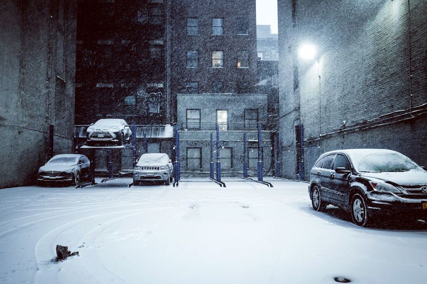 """New York City waking up under the Snowstorm """"Grayson"""" Parking Lot Snow Winter Cold Temperature Car Weather Transportation Mode Of Transport Snowing Blizzard Street City Street Frozen Outdoors Building Exterior Street Light"""