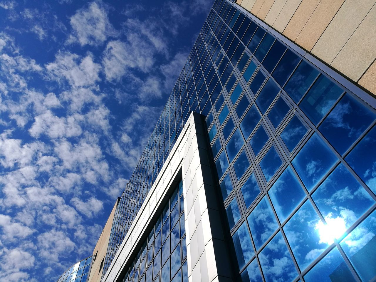 architecture, low angle view, modern, built structure, building exterior, sky, no people, day, window, outdoors, cloud - sky, blue