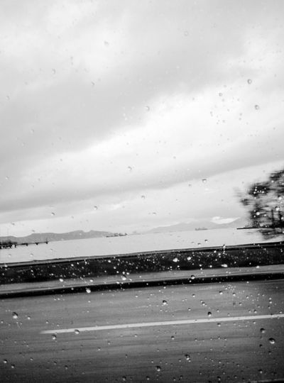 Rain Water Wet Drop Nature No People Rainy Season Sea Outdoors Day Cloud - Sky Landscape Scenics Beauty In Nature Sky Close-up Raindrops Cold Blurred Motion Different Perspective Going Home On The Road Car Ride  Let's Go. Together. Focus On The Story