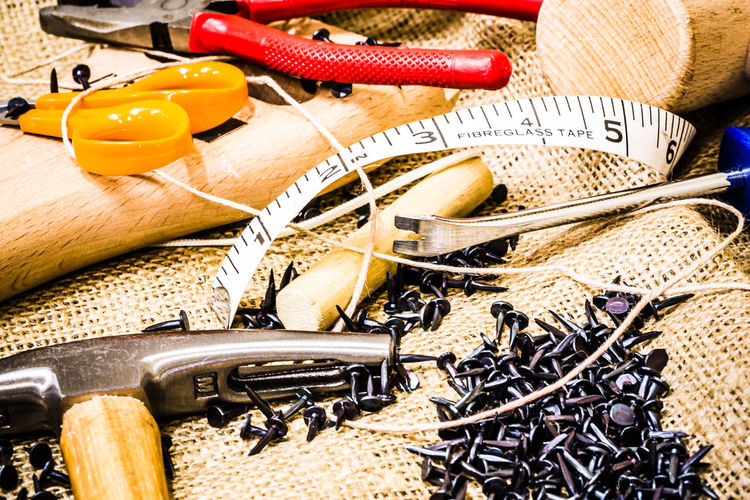A Selection of DIY Tools Construction DIY Do It Yourself Fibreglass Tape Measuring Tape Nails Scissors Self Build String Tools Of The Trade Camera Club Close-up Day Hammer Hand Tools Macro Maintenance Maintenance Work Mallet Nail No People Pliers Sacking Tacks Tools