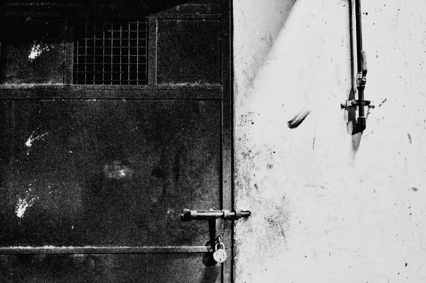 locked in the dark Slavery Racism Blackandwhite Black And White Lock Door Locked Closed Discrimination Truth Black & White Blackandwhite Photography Building Exterior Built Structure Day Outdoors No People Architecture