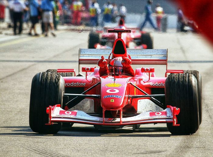Going through my old images I found this one of Michael Schumacher winning at the US GP 2003. Lots of great memories of a real champ, keep fighting Michael! Ferrari Formula 1 Michael Schumacher Transportation Red Mode Of Transportation Incidental People Racecar Focus On Foreground Day Outdoors Sports Race Competition Sunlight