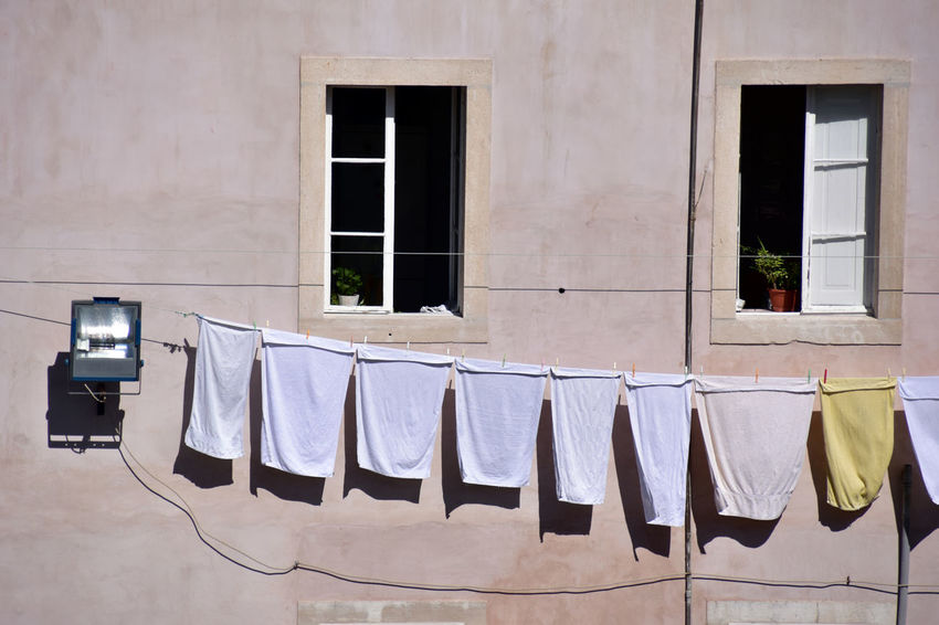 The way Portugese hang their clothes is just so neat and fun to watch Clothesline Drying Window Hanging Laundry No People Building Exterior Architecture Sunny Day☀ Outdoors Day Portugese Lisbon White Towels In The Wind Travel See Through The Camera