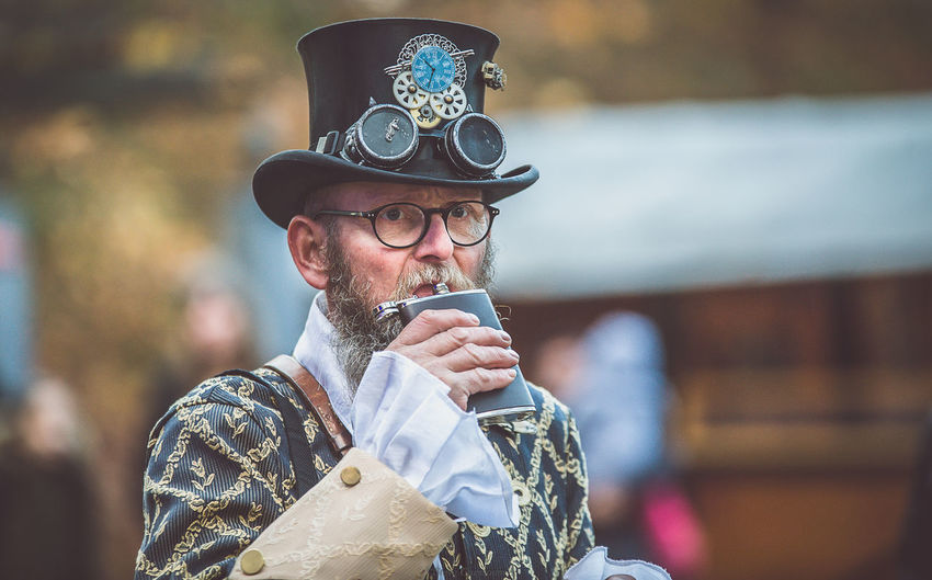 Portrait Of Man Wearing Hat Drinking With Hip Flask At Event