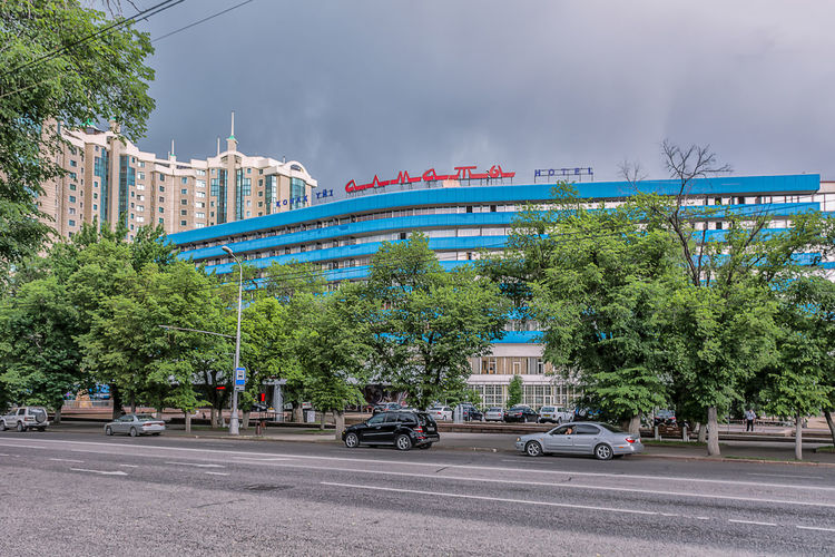 Almaty Almaty City Almaty, Kazakhstan AlmatyMyFirstLove Architecture Building Exterior Built Structure Car City Cloud - Sky Clouds And Sky Day Growth Kazakhstan Land Vehicle Nature Outdoors Road Sky Street Street Photography Streetphotography Transportation Tree Wether