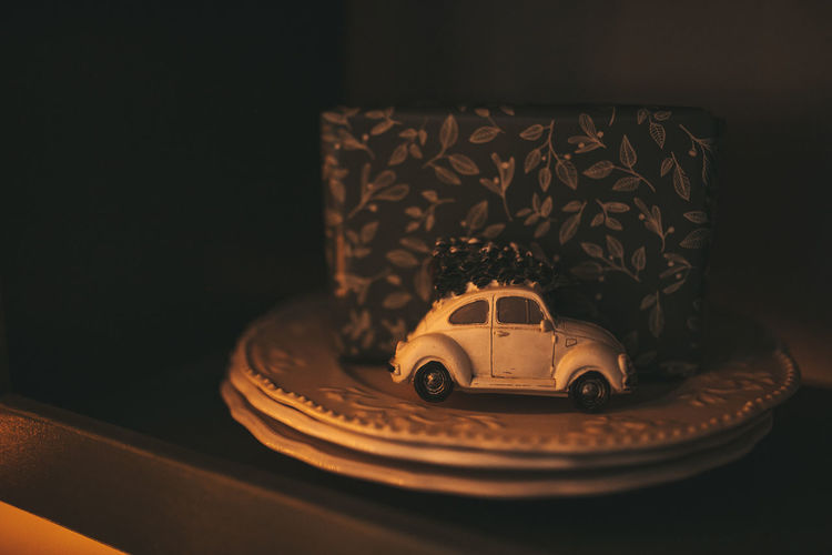 Close-up of toy car on table at home