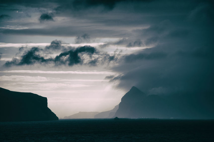 EyeEm Best Shots Beauty In Nature Cloud - Sky Faroe Islands Idyllic Land Mountain Nature No People Non-urban Scene Outdoors Power In Nature Remote Scenics - Nature Sea Sky Storm Tranquil Scene Tranquility Water Waterfront HUAWEI Photo Award: After Dark