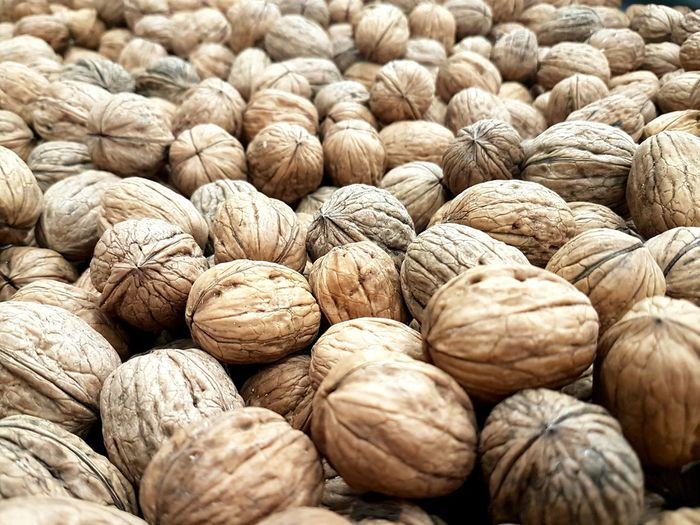 Full frame shot of walnuts for sale at market stall