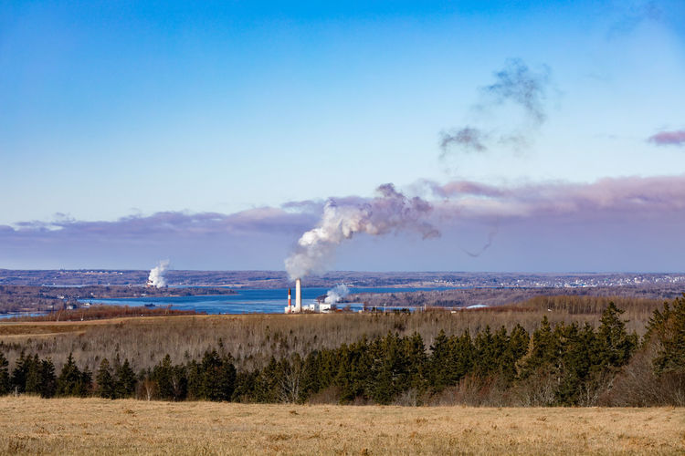 Coal Power Plant and Paper Mill in Pictou County winter landscape, Nova Scotia, NS, Canada Pictou County Rural Scene Rural Landscape Nova Scotia Nova Scotia, Canada Canada Ns Coal Power Plant Paper Mill Industry Industrial Pollution Pollute Polluter Winter Wintertime Countryside Smoke - Physical Structure Environment Water Land Nature Emitting No People Environmental Issues Factory Plant Smoke Smoke Stack Sea Outdoors Air Pollution