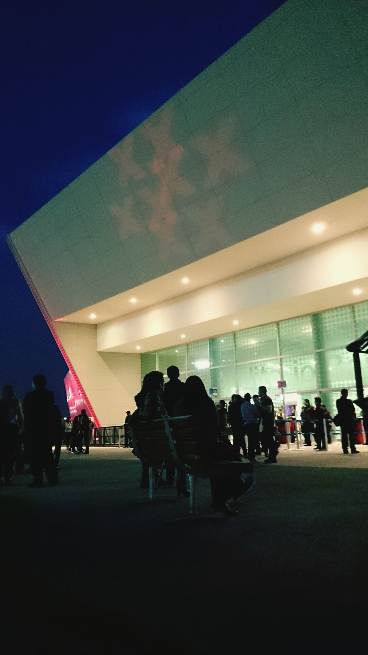 large group of people, person, men, indoors, architecture, illuminated, lifestyles, built structure, leisure activity, crowd, city life, night, lighting equipment, city, modern, building exterior, ceiling, group of people, arts culture and entertainment