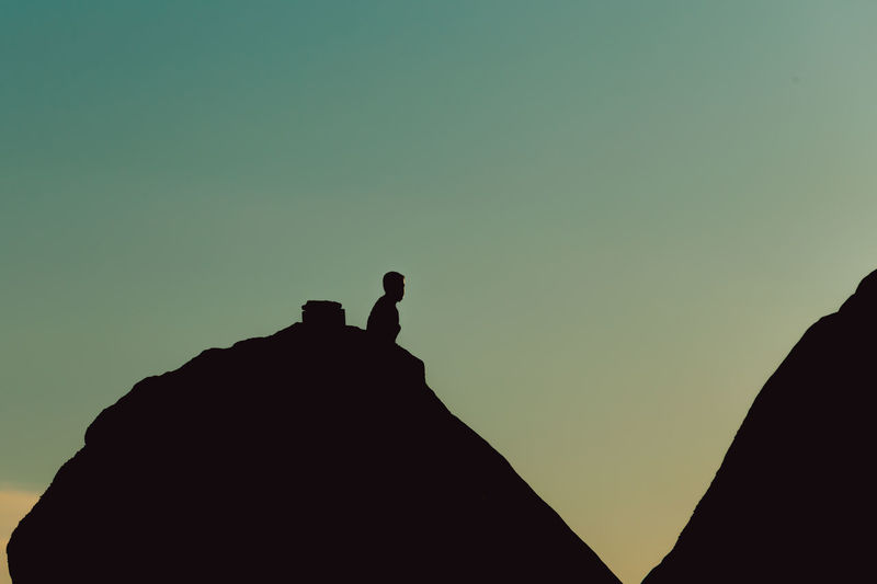 Low angle view of silhouette person against sky during sunset