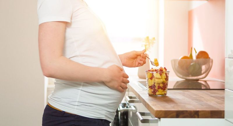 Indoors  Food And Drink Celebration Table Holding Lifestyles Togetherness Front View Freshness Person Young Adult Home Kitchen Pregnant Bright Freshness Healthy Belly Mum Food Mother Flower Domestic Life