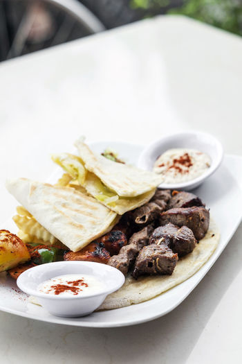 mixed grilled meat lebanese traditional meal Lebanese Food Meal Bbq Meat Close-up DIP Food Food And Drink Freshness Grilled Meat Lebanese Meat Middle Eastern Food No People Pita Bread Plate Platter Ready-to-eat Set Meal Traditional