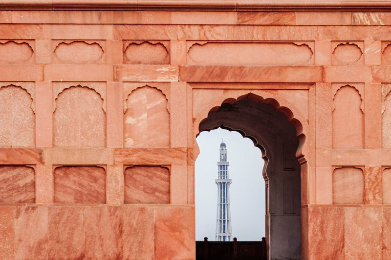 Tower seen through arch of historical building