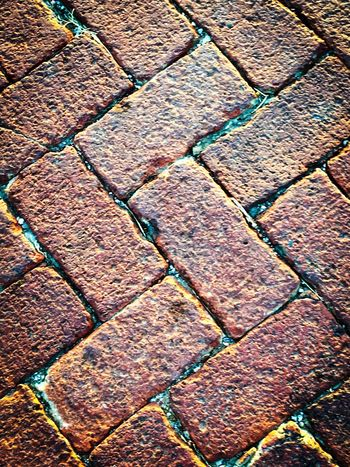 Red Brick Road Red Brick Road Old Road Brick Textured  Pattern Backgrounds No People Man Made Object Full Frame IPhone IPhoneography Footpath Redbrick Iphoneonly Street Red Textures And Surfaces Texture Textures Patterns Maximum Closeness The Drive Beautifully Organized