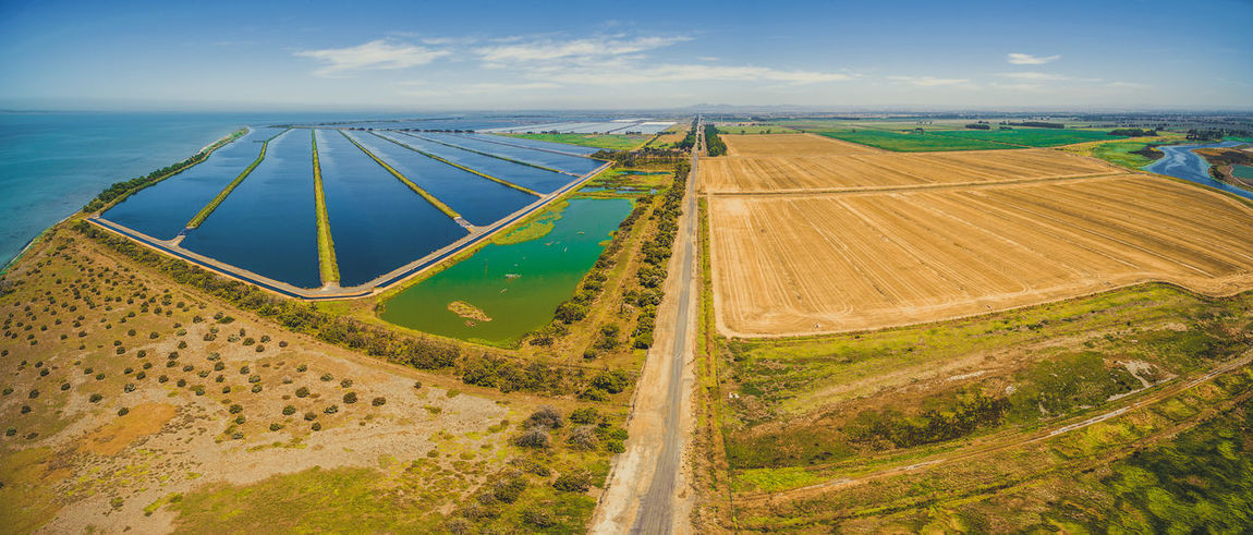 Aerial panoramic view of waste water treatment plant pools and plowed fields at Cocoroc, Melbourne, Australia Agriculture Australia Drone  Field Plant Water Treatment Plant Aerial Aerial Landscape Aerial View Agricultural Land Beauty In Nature Cloud - Sky Cocoroc Day Drone Photography High Angle View Landscape Melbourne Nature No People Outdoors Plowed Field Road Scenics Sky Tranquil Scene Tranquility Treatment Water