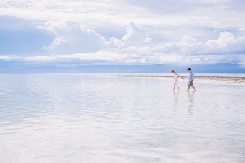 Two People Real People Horizon Over Water Water Outdoors Vacations Nature Beauty In Nature Hand With Walking Couple Love Together Happy People Paradise Paradise Beach Bohol Phillipines Sky And Clouds Glitter Travel Lifestyles White Dress
