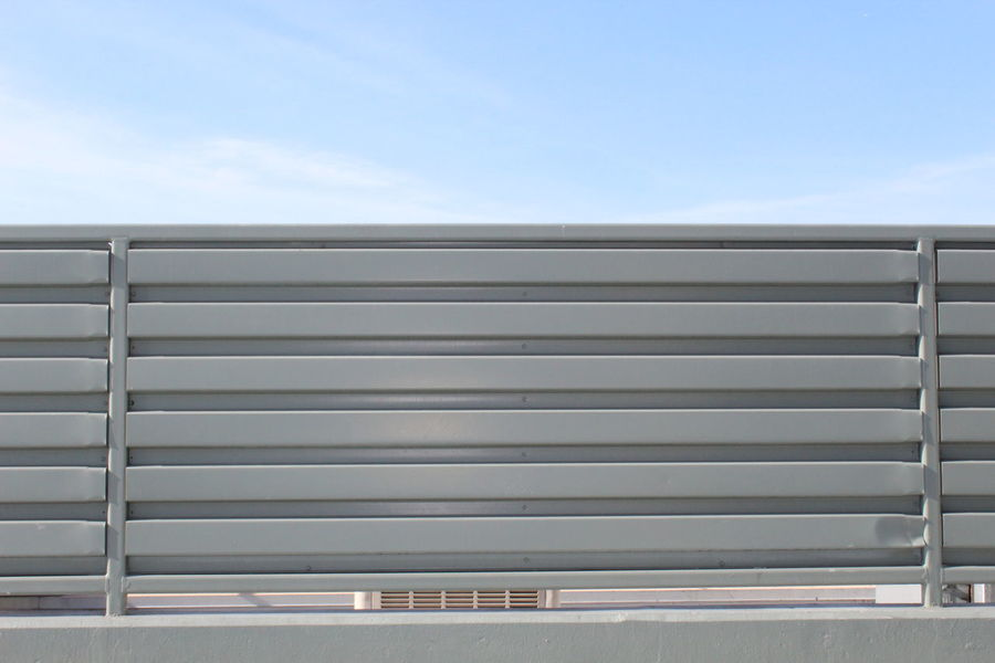 Silver Colored Closed Metal Security Silver - Metal Steel Shiny Aluminum Outdoors Industry Corrugated Iron Day No People Close-up